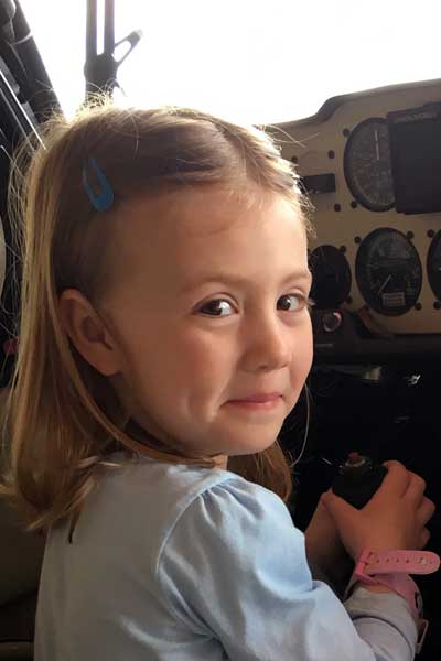 Alexis, age 4½, seated at the controls of my plane